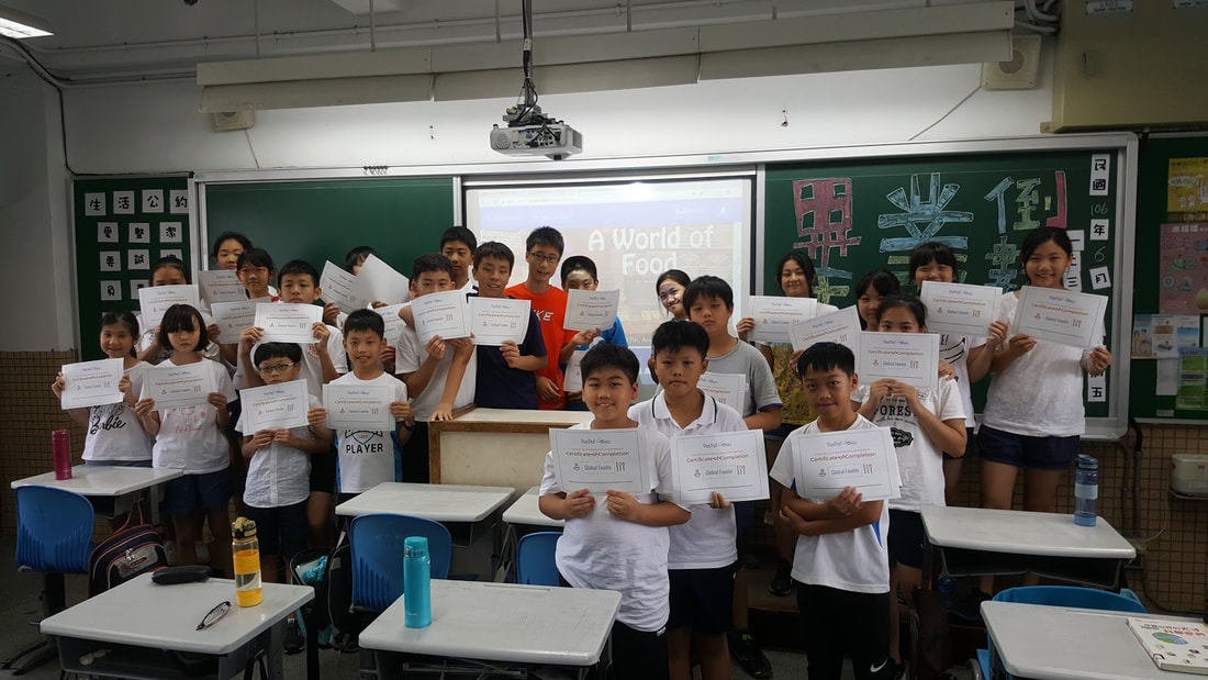 Picture of students with certificates after completing global education project